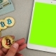 Man Holds Golden Bitcoin in a Hand with Ipad Chromokey - VideoHive Item for Sale