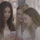 Girls Friends Looking at Phone in Shopping Center - VideoHive Item for Sale