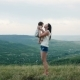 Mom Walks with Her Son Standing on the Mountain - VideoHive Item for Sale