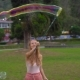 Shot of a Young Woman Making a Big Soap Bubles in a Park - VideoHive Item for Sale