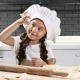 Little Cute Girl Pretending Chef in Cook Hat in Kitchen Rolling Dough with a Rolling Pin Making - VideoHive Item for Sale
