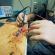 Man with Prosthetic Hands Is Soldering a Microscheme - VideoHive Item for Sale