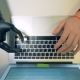 Laptop Keypad Getting Typed on By a Robotic Cyborg Arm - VideoHive Item for Sale