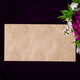 Mockup with paper envelope and flower on dark background.  - PhotoDune Item for Sale