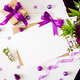 Mockup. Cards and flowers, box gift,violet ribbon and cloth lying on a white table - PhotoDune Item for Sale
