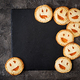 Homemade  cookies in the form as Halloween  jack-o-lantern pumpkins  on the dark table. Top view. - PhotoDune Item for Sale