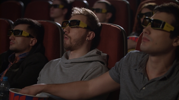 a2736db883d Male Friends Wearing 3d Glasses in Cinema by stockbusters