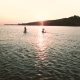 Silhouette of SUP Boarding Women. Girls Stand Up Paddle Board at Sunset - VideoHive Item for Sale
