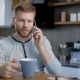 Man Speaking on Smartphone During Breakfast - VideoHive Item for Sale