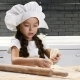 Little Girl in Chef Hat Playing with Dough and Rolling Pin Laughing Having Fun - VideoHive Item for Sale