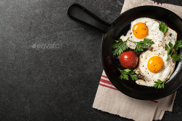 Fried eggs with tomato - Stock Photo - Images