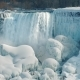 Magnificent View of the Frozen Niagara Falls. Water Flows Among the Rocks Covered with Ice and Snow - VideoHive Item for Sale