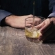 Man Holding a Glass of Ice and Pour Whiskey - VideoHive Item for Sale