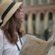 Side View of Young Caucasian Tourist Standing in Nice, France with a Map - VideoHive Item for Sale