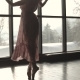 Portrait of a Ballerina in a Long Transparent Dress Against the Background of a Large Window - VideoHive Item for Sale