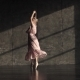 A Young Ballerina in a Long Fluttering Dress Is Danced on Tiptoes in Pointe Shoes - VideoHive Item for Sale