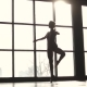 Silhouette Graceful Ballerina on the Background of a Large Window. Ballet Dancer in Pointe Shoes - VideoHive Item for Sale