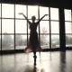 The Silhouette of a Ballerina Swirling on Tiptoes in Pointe Shoes and a Long Fluttering Dress - VideoHive Item for Sale