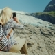 Woman Tourist Taking Pictures of the Glacier. Traveling in Norway Concept - VideoHive Item for Sale