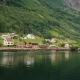 A Picturesque Village with Traditional Wooden Houses on the Shore of the Fjord in Norway - VideoHive Item for Sale
