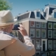 A Middle Aged Woman Takes Pictures of Buildings and a Canal in Amsterdam - VideoHive Item for Sale