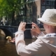 An Active Traveler Woman Takes Pictures of a Beautiful View of the Canal in Amsterdam - VideoHive Item for Sale