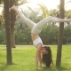 Handstand Yogi Woman Practicing Yoga Downward Facing Tree Pose - VideoHive Item for Sale