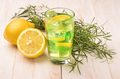 Glass of fresh homemade lemonade with tarragon and lemon - PhotoDune Item for Sale