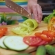 Female Hands of Housewife with a Knife Cut Fresh Bell Pepper on Chopping Board Kitchen Table - VideoHive Item for Sale