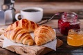 Homemade baked croissants with jam and coffee on wooden rustic background - PhotoDune Item for Sale