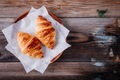 Homemade baked croissants on wooden rustic background. Top view - PhotoDune Item for Sale