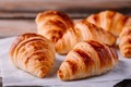 Homemade baked croissants on wooden rustic background - PhotoDune Item for Sale