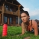 Beautiful Brunette on the Background of a Large Mansion Engaged in Fitness and Performs Plank - VideoHive Item for Sale