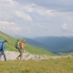 Group of Hiking People Traveling in Mountain on Green Hills and Sky Background - VideoHive Item for Sale