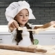 Portrait of Little Pretty Girl in Chef Hat Playing with Dough, Kid Cook in Real Kitchen - VideoHive Item for Sale
