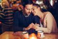 Romantic couple dating in pub at night - PhotoDune Item for Sale
