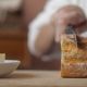 Of Women Hands With A Knife Cut Bread And Spread Butter On It - VideoHive Item for Sale