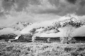 Teton Mountain Range with Moulton Barn in clouds. - PhotoDune Item for Sale
