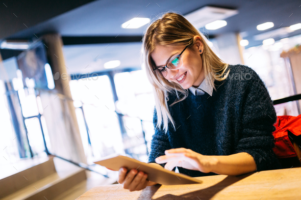 Portrait of young attractive woman using tablet - Stock Photo - Images