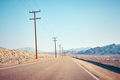 Desert road with wooden electricity posts. - PhotoDune Item for Sale