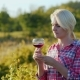 Tourist Tasting Wine Against the Vineyard Background - VideoHive Item for Sale