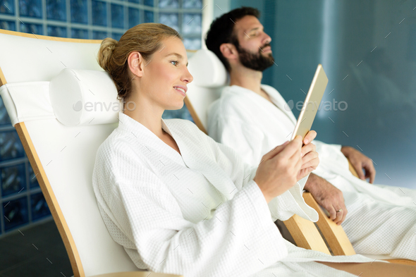 Attractive happy couple relaxing in spa center - Stock Photo - Images