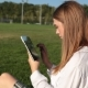 Young Woman with a Tablet. Girl in the Park with a Tablet Computer - VideoHive Item for Sale