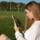 A Tablet and a Beautiful Young Woman in a Park - VideoHive Item for Sale