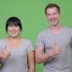 Young Multi-ethnic Couple Giving Thumbs Up Together - VideoHive Item for Sale