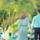 Young Couple Walk Through a City Park Together Heading Away From the Camera - VideoHive Item for Sale