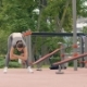 Athlete Woman Doing Slopes Exercises While Outdoor Training in Summer Park - VideoHive Item for Sale