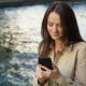 Freelancer Woman Browsing in Smartphone, Sitting Against River Water - VideoHive Item for Sale