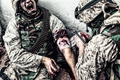Military medic binding gunshot wound during fight - PhotoDune Item for Sale