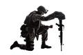 Sad soldier kneeling because of friend death - PhotoDune Item for Sale